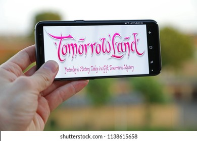 BOOM,BELGIUM-JULY 20TH 2018: hand holding a new Samsung S9 phone which displays the Tomorrowland logo on the touch screen. Tomorrowland is a electronic music festival in Belgium.Illustrative editorial