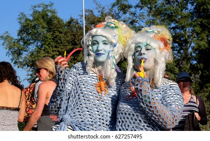 Boomtown Fair Festival - August 14 2016: Festival goers with blue painted faces and white wigs in a crowd at Boomtown Fair, Matterley Bowl, Winchester, Hampshire, August 14 2016, in Hampshire, UK