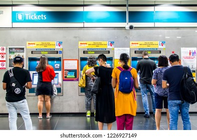 BOON KENG, SINGAPORE - NOV 2, 2018: Passenger queues at Ticket Vending Machines in Boon Keng MRT Station waiting for buying tickets or topping up transport cards