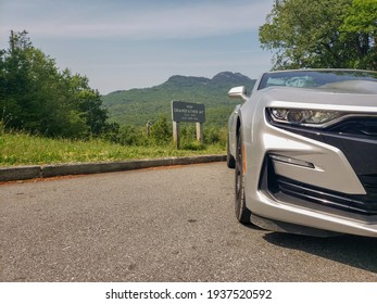 Boone, North Carolina, United States - April 2nd 2020: Camaro SS paired with a spectacular view of Grandfather Mtn