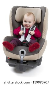 booster seat for a car in light background. studio shot with kid