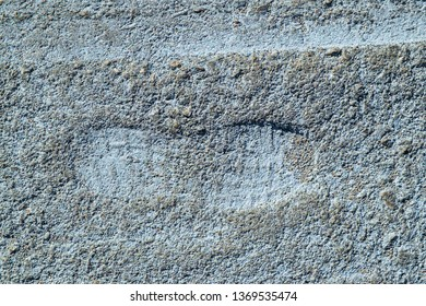 Boot footprint on textured soil