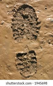 Walker's Boot print in wet mud