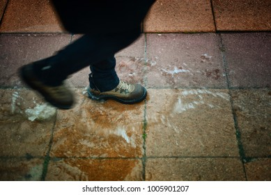 Boot splashes water on a rainy day