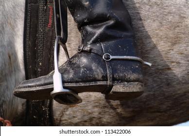 A boot in a stirrup, closeup