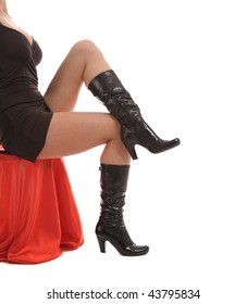 booted slim woman legs isolated on white background
