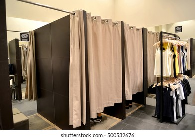 "Booth fitting rooms in women's clothing shop, Poland. Inscription on a sign in Polish: ""You look for something, but you can't find?"""