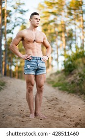 Bootlessly muscular young man in a forest.