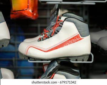Boots for classic ski riding on stands in outdoor sport store