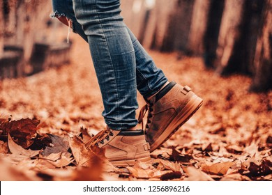 Boots in a field of leaves in autumn