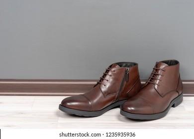 Boots men on white wooden floor
