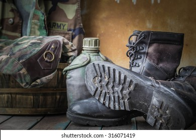 boots of soldiers placed on a wooden