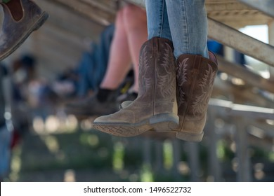 boots of spectators in the stands