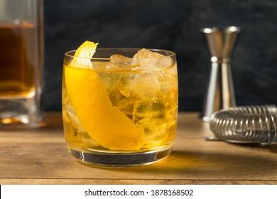 Boozy Refreshing Rusty Nail Cocktail with Lemon Garnish - Shutterstock ID 1878168502