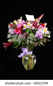 Boquet of flower with blank greeting card.