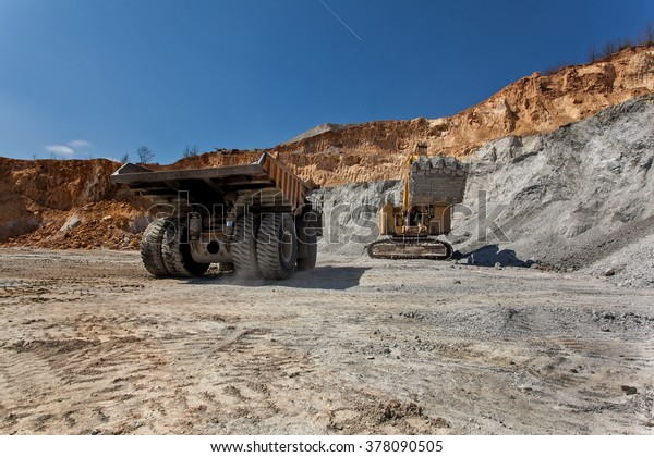 Bor, Serbia - April 15.2015 Group of tourists visiting the Open pit copper mineVeiliki Krivelj at Bor, Serbia. A close encounter with a large excavator