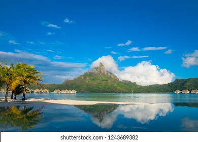 Bora Bora beach with reflection in turquoise water, Tahiti, French Polynesia