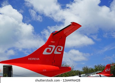 BORA BORA, FRENCH POLYNESIA -2 DEC 2018- View of an ATR regional jet airplane from the Air Tahiti airline (VT) at the Aeroport de Bora Bora Motu Mute airport (BOB) in French Polynesia.