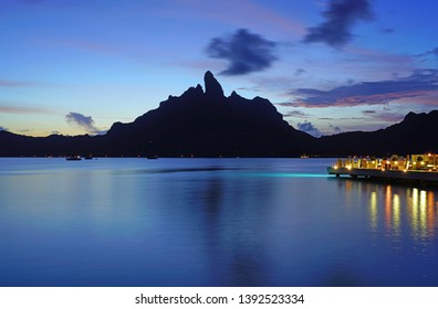 BORA BORA, FRENCH POLYNESIA -4 DEC 2018- Night view of the Mont Otemanu mountain  seen from the St Regis Bora Bora resort over the lagoon in French Polynesia, South Pacific.