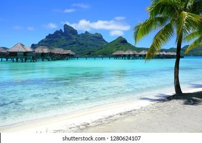BORA BORA, FRENCH POLYNESIA -7 DEC 2018- View of the turquoise blue lagoon and the Mont Otemanu mountain seen from the Four Seasons Bora Bora resort.