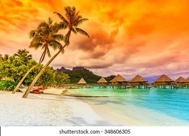 Bora Bora, French Polynesia. Otemanu mountain, beach and palm trees.