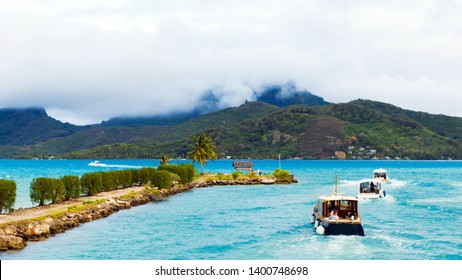 BORA BORA, FRENCH POLYNESIA - SEPTEMBER 19, 2018: Boats near the coast in the background of a mountain landscape