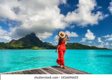 Bora Bora island luxury resort hotel woman relaxing at view of Mt Otemanu in Tahiti, French Polynesia Honeymoon travel destination for summer vacation.