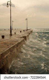Bora, a stormy wind. A cold and windy day in Trieste. Molo Audace pear.