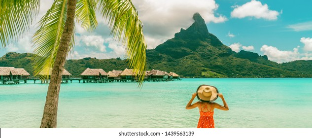 Bora Bora Tahiti luxury beach vacation woman happy enjoying sun on Bora Bora private island, French Polynesia with Mount Otemanu in background and overwater bungalows hotel banner panorama.