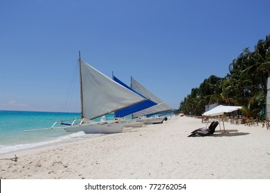 Boracay - August 12 2014: Boats parked by the beach