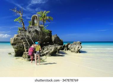 BORACAY BEACH,PHILIPPINES-FEBRUARY 25, 2014:People relaxing on Boracay beach,Philippines