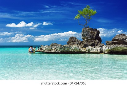 BORACAY BEACH,PHILIPPINES-FEBRURY 24, 2014:People relaxing on Boracay beach,Philippines