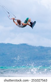 """Boracay island, Philippines - January 28, 2015 : unidentified kite-surfer performs in competitions """"The Boracay internanional funboard cup 28-31 January, 2015"""" Freestyle category."""