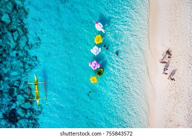 Boracay island, Philippines, top view of people enjoying the beach on a sunny day.