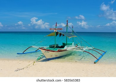 BORACAY, PHILIPPINES - April 28, 2013: Bangka - a traditional boat in Philippine, Puka Beach.