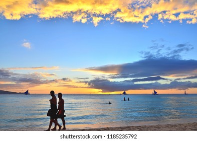Boracay, Philippines - December 4, 2015 :  Tourist evening activity during the sun set at the scenic beach of Boracay