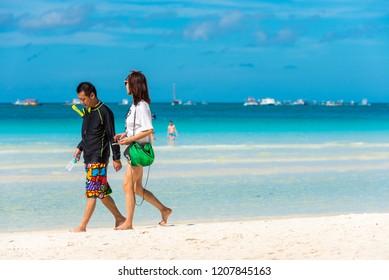 BORACAY, PHILIPPINES - FEBRUARY 28, 2018: Couple on a sandy beach.