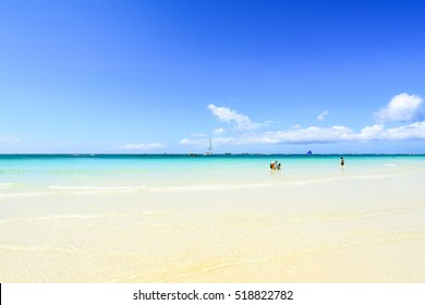 BORACAY, PHILIPPINES - JANUARY 10, 2015 - An overview of the White Beach of Boracay , with many tourists relax by walking or swimming.