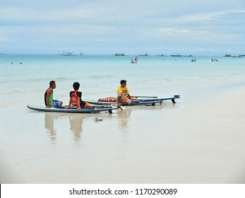 BORACAY, PHILIPPINES - JULY 22, 2015 : Young People playing Paddle Board at Boracay island