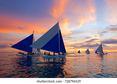 BORACAY, PHILIPPINES - JULY 29, 2015: Sunset Sailing at the famous White Beach of the Boracay Island, Philippines