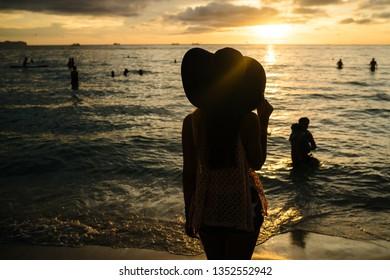 BORACAY PHILIPPINES - Nov 17, 2017: Unknown people on beautiful White beach of Boracay Island in sunset