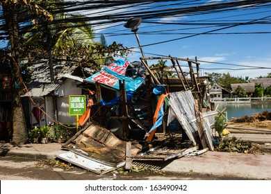 BORACAY, PHILIPPINES - NOVEMBER 9 2013: A wooden shack lies completely in ruins following Super Typhoon Haiyan in the Philippines.  Haiyan is one of the strongest storms ever recorded to have hit land