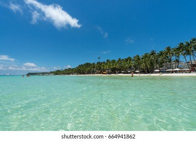 BORACAY, WESTERN VISAYAS, PHILIPPINES - MARCH 27, 2017: Turquoise water and coconut trees makes the White Beach wonderful place to relax.
