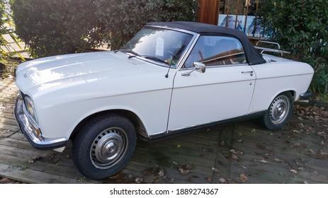 Bordeaux , Aquitaine  France - 01 05 2021 : peugeot 304 white convertible vintage retro car of 1970 seventies