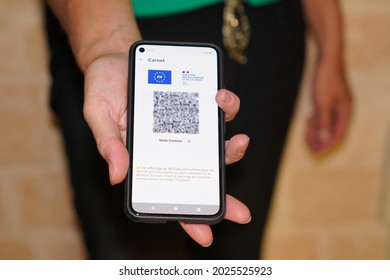Bordeaux , Aquitaine France - 08 10 2021 : European sanitary pass with QR code on a smartphone screen in hand