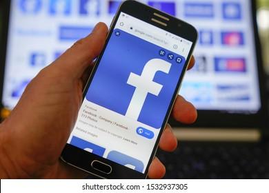 Bordeaux , Aquitaine / France - 10 11 2019 : Man connect french Facebook smartphone laptop largest social media network web phone app