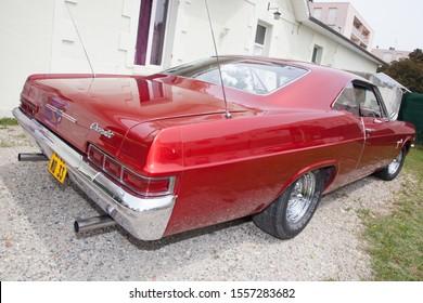 Bordeaux , Aquitaine / France - 11 07 2019 : vintage Chevrolet Impala red car