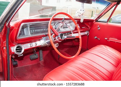 Bordeaux , Aquitaine / France - 11 07 2019 : Chevrolet Impala red interior dashboard steering wheel instruments in Classic historic luxury car in perfect condition