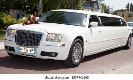 Bordeaux , Aquitaine / France - 11 07 2019 : limousine white long car limo for wedding flowers decoration