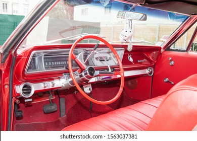 Bordeaux , Aquitaine / France - 11 13 2019 : Chevrolet Impala red leather interior dashboard steering wheel instruments in Classic american car
